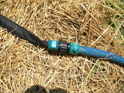 Hook The Gilmour Flat Soaker Hose To The Water Hose