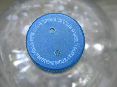 Two Drilled Holes In Soda Bottle